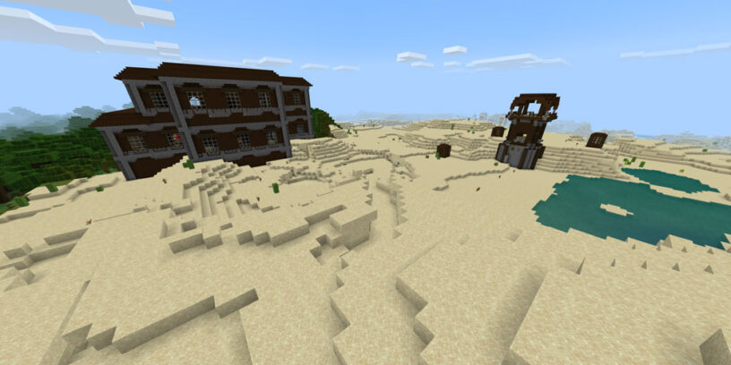 Mansion and Pillager Outpost next to each other in desert biome in Minecraft