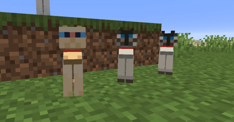 Three tamed cats sitting with collars on in Minecraft