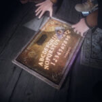 Ouija Board lit up in Phasmophobia
