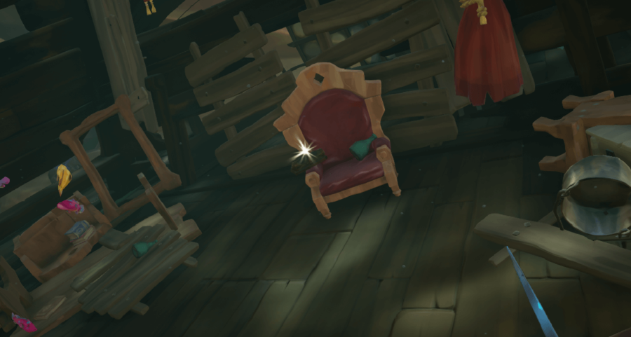 The Magpie's Wing Ship's Log in a chair.