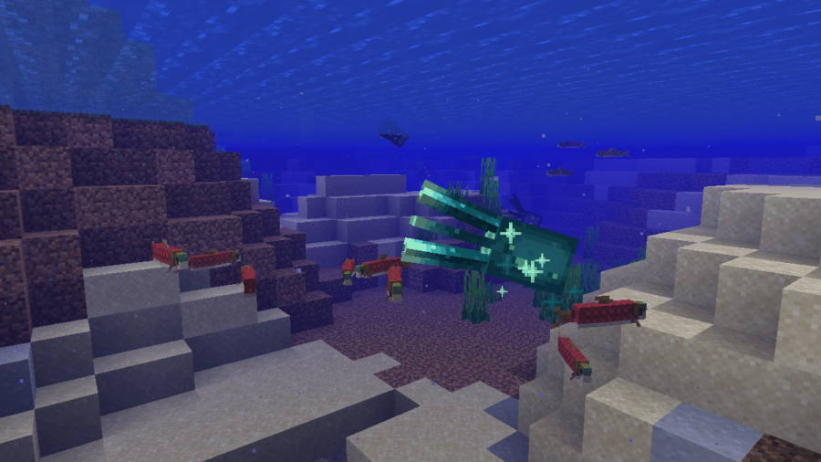 A screenshot of a glowing squid with fish in Minecraft.