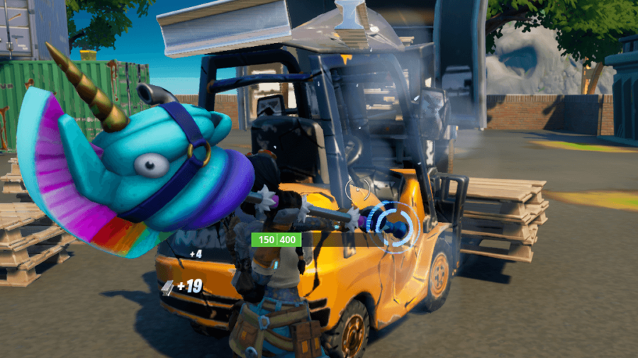 A Fortnite character breaking a forklift for mechanical parts.