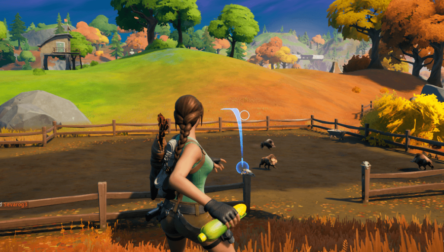 A character throwing corn to a boar in Fortnite.