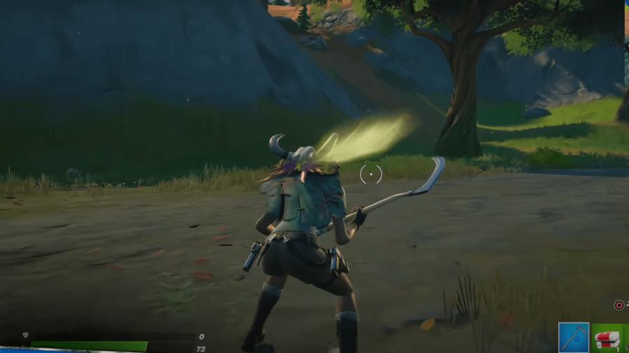 Lara Croft howling at a full moon in a Hunters Cloak.