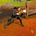 John Wick crouching in Fortnite.