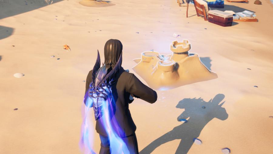 Destroying a sandcastle in Fortnite.