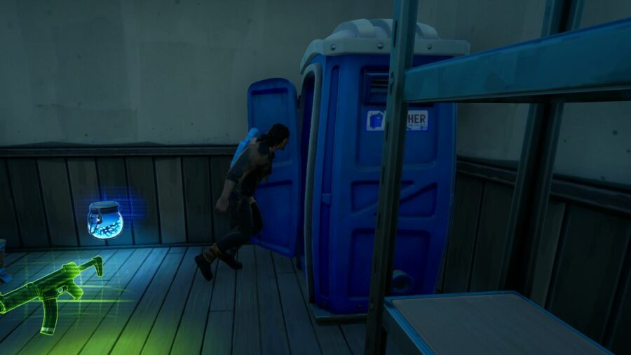 Darryl rushing into a porta potty.