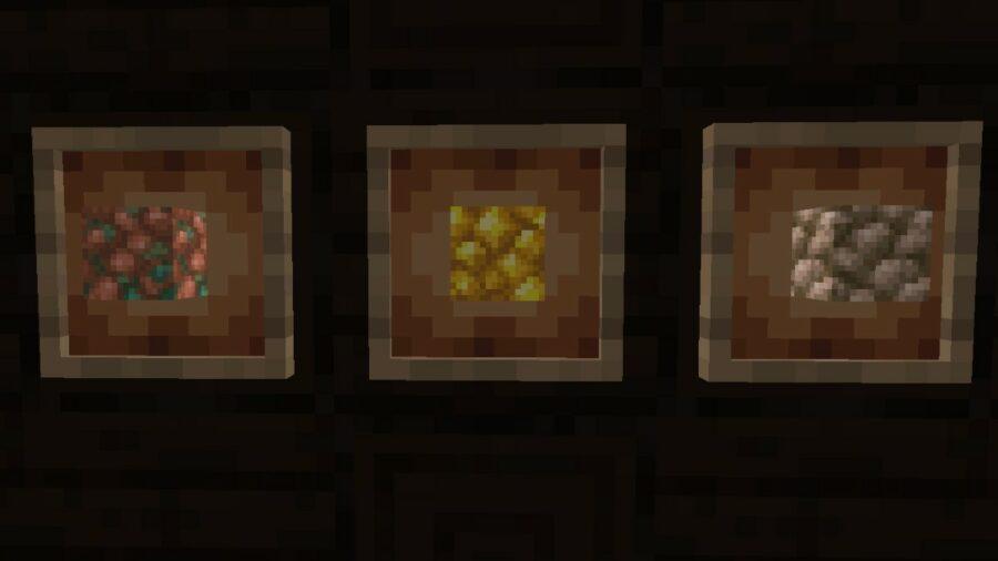 Blocks of Raw Ore in glowing item frames.