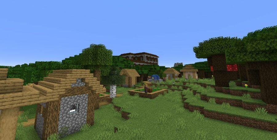 A Village by a Mansion in Minecraft.